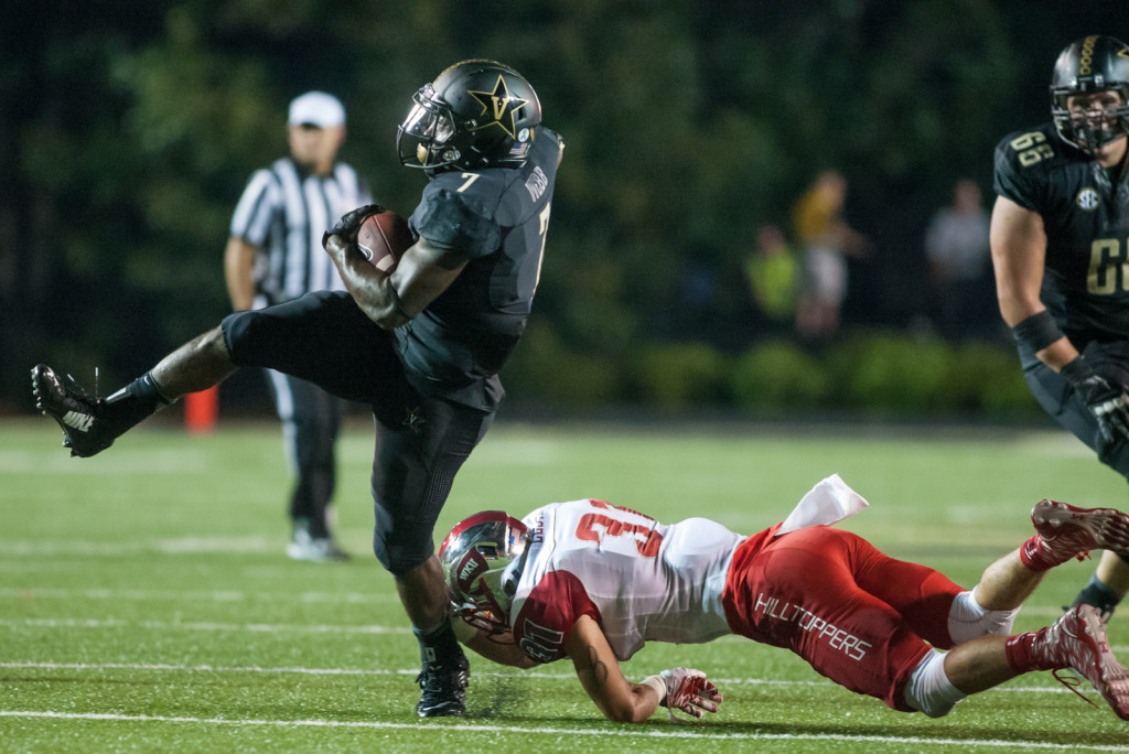 Ralph Webb (7) runs the ball during Vanderbilt's 14-12 loss against the Western Kentucky Hilltoppers September 3, 2015 at Vanderbilt Stadium Nashville, TN.
