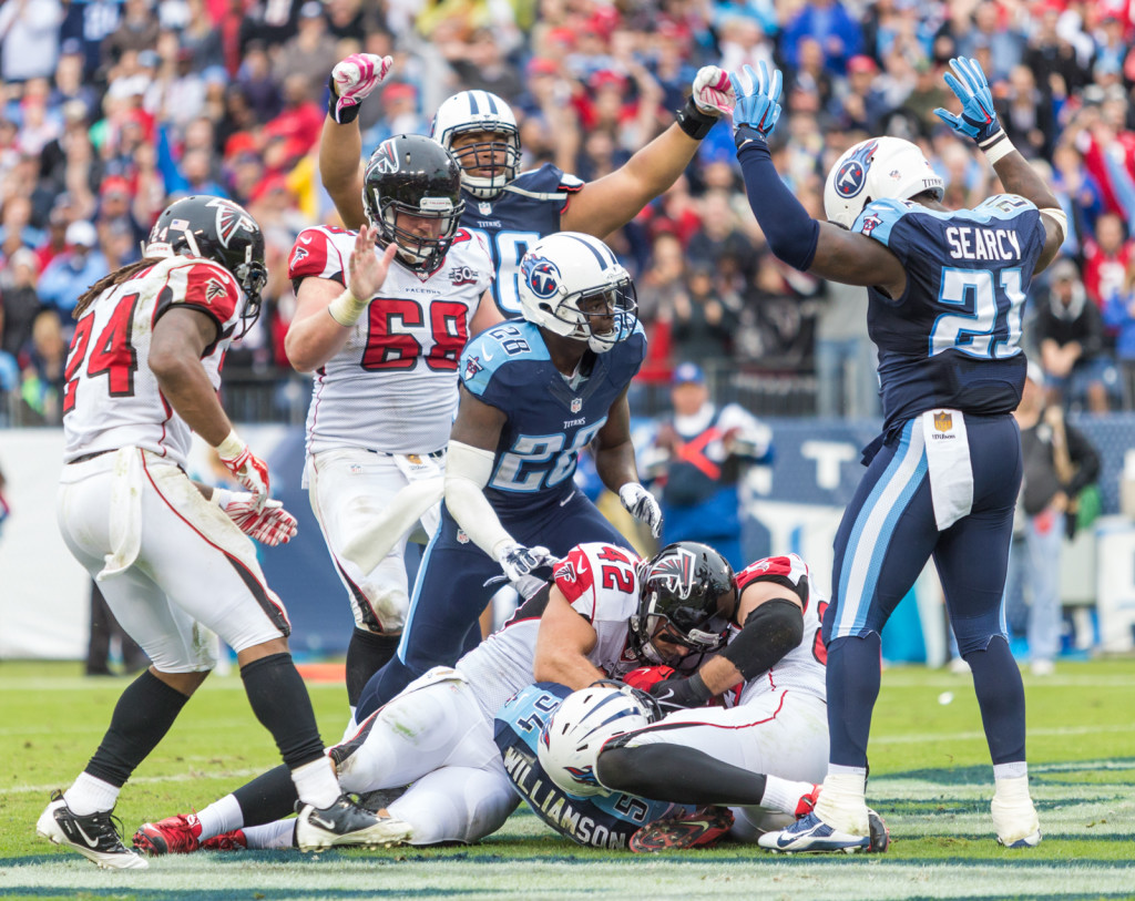 Jacob Tamme (83) bobbles a pass that is intercepted by Avery Williamson (54) as the Atlanta Falcons defeated the Tennessee Titans 10-7 at Nissan Stadium Nashville, TN October 25. 2015.